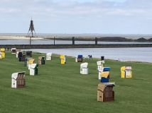 The famous Cuxhaven lighthouse, and a field of beachbaskets